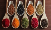 Herbs and spices in wooden spoons - beautiful kitchen image.